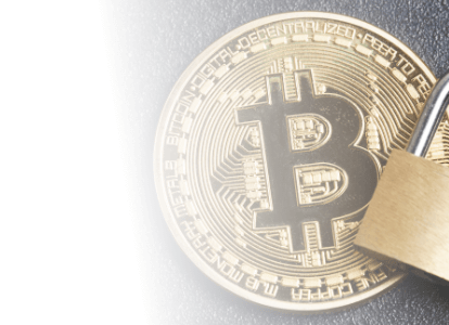 Zoomed in bitcoin token with lock showing security metaphorically