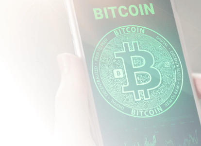 Bitcoin name and logo colorized in Coinstar green displayed on a phone held in hand
