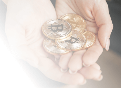 Hands cupping bitcoin tokens with white gradient