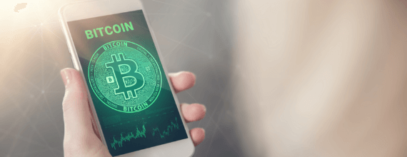 Coinstar green colored bitcoin name and logo displayed on a phone held in a hand
