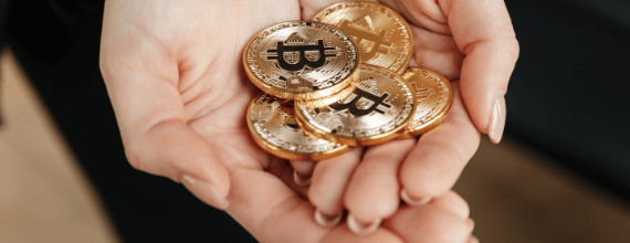 Bitcoin tokens held in cupped hands reverently