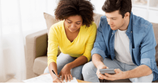 Couple, man and woman, considering bitcoin for their finances